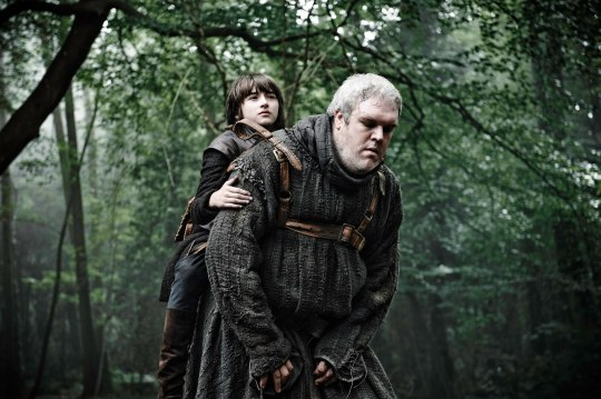 Photo of Kristian Nairn as the giant simpleton Hodor, tasked with carrying the crippled boy Bran Stark (Isaac Hempstead Wright) in HBO's 'Game of Thrones' broadcast on Sky Atlantic © HBO