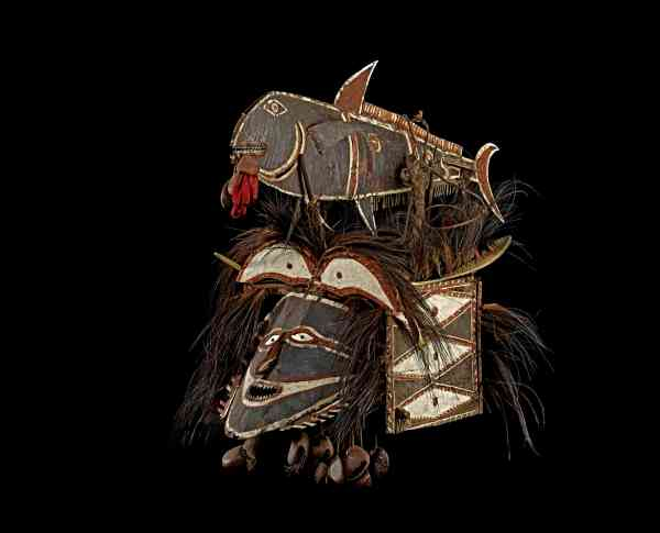 Mask in the form of a human face and a bonito fish, Attributed to Kuduma, Murala.  Turtle shell, goa nut, cassowary feather, shell. Nagir, Torres Strait, Queensalnd, Australia before 1888.  © The Trustees of the British Museum.