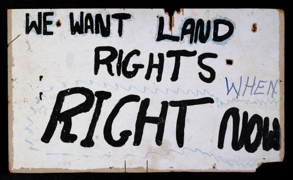 Land rights placard from the aboriginal Tent embassy, erected, as a site of protest, in 1972.  Paint on Masonite board, Old Parliament House, Canberra, Australia (1972) National Museum of Australia