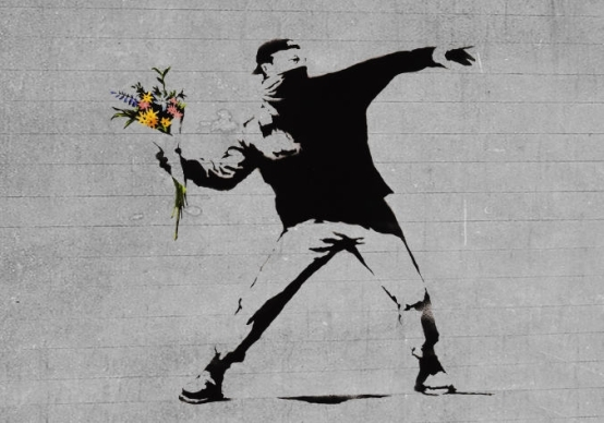 Rioter throwing flowers by Banksy