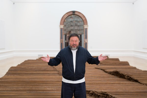 Ai Weiwei with his installation Straight, Royal Academy of Arts (2015) Photo courtesy of Royal Academy of Arts, London. Photography © Dave Parry