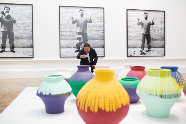 Ai Weiwei taking a photograph of his installation Coloured Vases, Royal Academy of Arts (2015) Photo courtesy of Royal Academy of Arts, London. Photography © Dave Parry