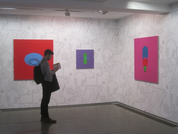 Installation view of Untitled (smoke alarm) (2014), Untitled (hotel door handle) (2014) and Untitled (light bulb) (2014) by Michael Craig-Martin at the Serpentine Gallery. Photo: Simon Port
