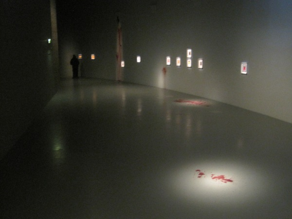 Early part of the installation showing bloodstains on floor and wall