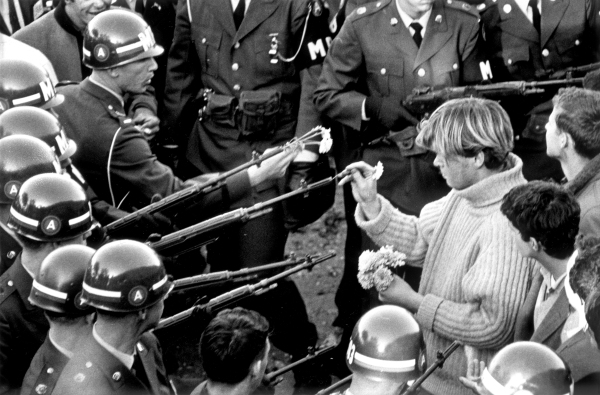 ARLINGTON, VA - OCTOBER 26 1967: Antiwar demonstrators tried flower power on MPs blocking the Pentagon Building in Arlington, VA on October 26, 1967. (Photo by Bernie Boston/The Washington Post via Getty Images)