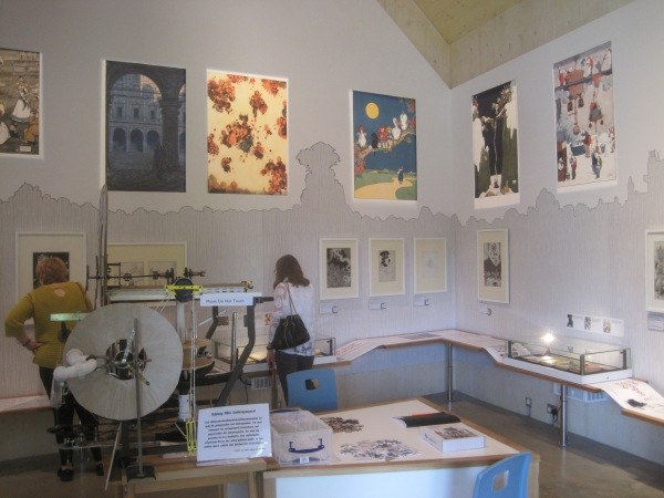 The Heath Robinson Museum showing the waist-level information shelf, mid-height prints, and high-up posters, plus the model contraptions in the middle