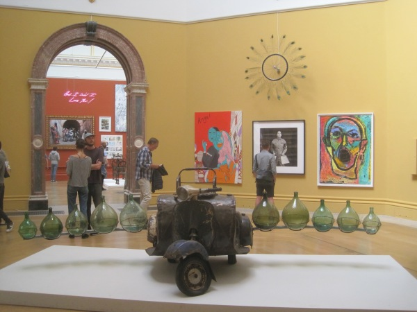 View of the Wohl Central Hall featuring Petrol Cargo by Romuald Hazoume and Very Nice Ride by Paola Pivi