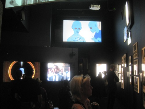 Installation view showing several of the video screens shoing clips from classic sci-fi movies