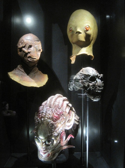 Monster masks: top right Close Encounters; bottom left from Species II by H.R. Giger; in the middle a skull and mask from Enemy Mine