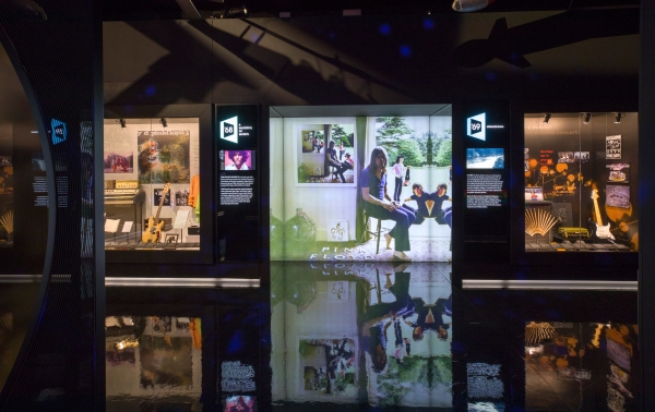 Installation view: left, a case about A Saucerful of Secrets; a TV monitor showing Syd Barrett; centre the clever-clever artwork for Ummagumma