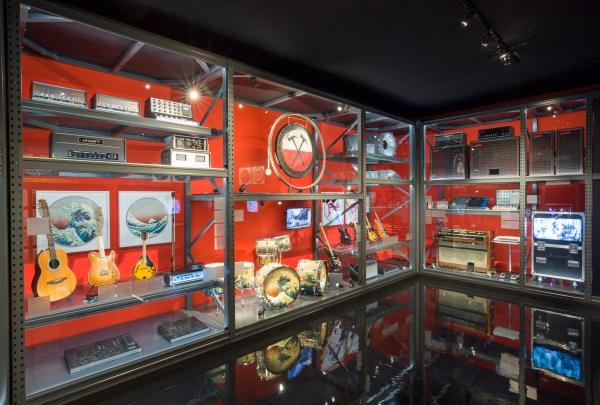 Display case of guitars and technical equipment