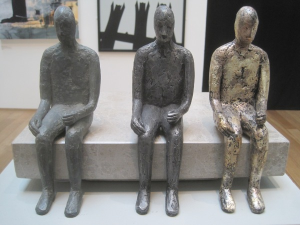 Trilogy by William Cramer. Bronze figure, aluminium figure, silver leaf resin figure on stone base (£2,000)