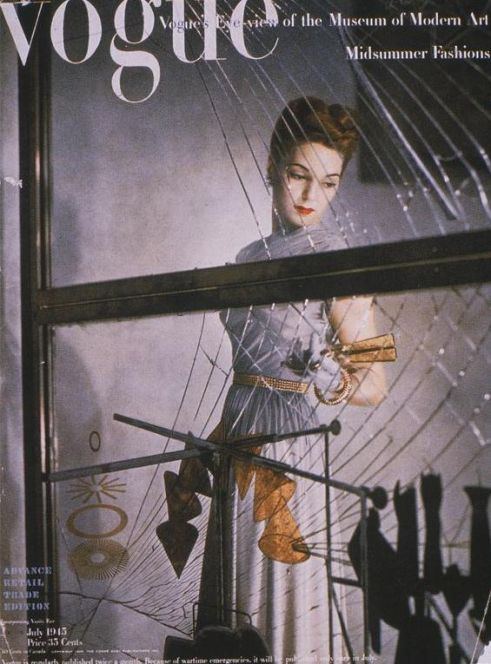 Cover of Vogue (1945) Model posing with Marcel Duchamp's The Large Glass, photographed by Erwin Blumenfeld