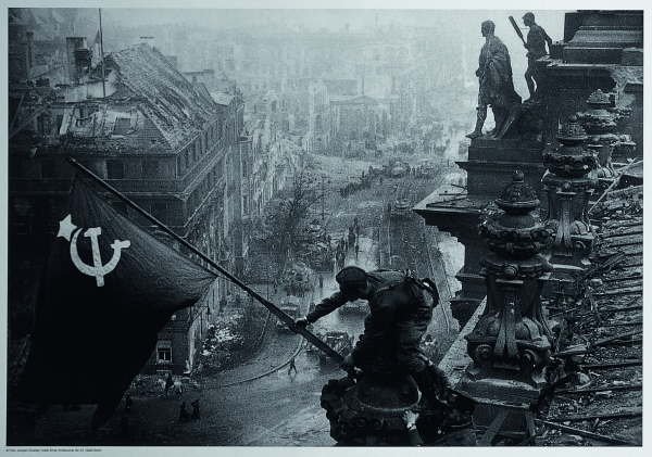 Soviet soldiers raising the red flag over the Reichstag, May 1945 (Printed 1955) by Yevgeny Khaldei. The David King Collection at Tate