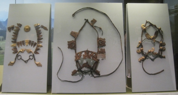Horse bridles - the central one features plaques representing eagles, rams' heads and a mythical predator (Late 4th-early 3rd century BC) Burial mound 1, Pazyryk, Altai Mountains, southern Siberia