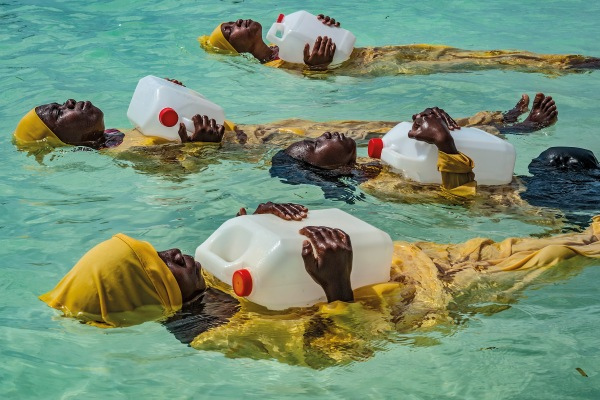 Kijini Primary School students learn to float, swim, and perform rescues in the Indian Ocean off of Mnyuni, Zanzibar by Anna Boyiazis, 2016 © Anna Boyiazis
