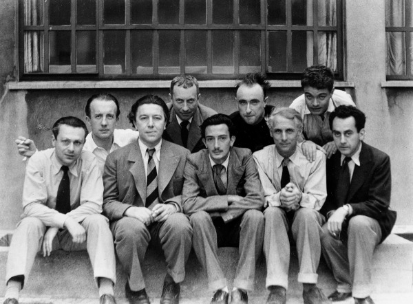 Left to right: Tristan Tzara, Paul Éluard, André Breton, Hans Arp, Salvador Dali, Yves Tanguy, Max Ernst, René Crevel, Man Ray