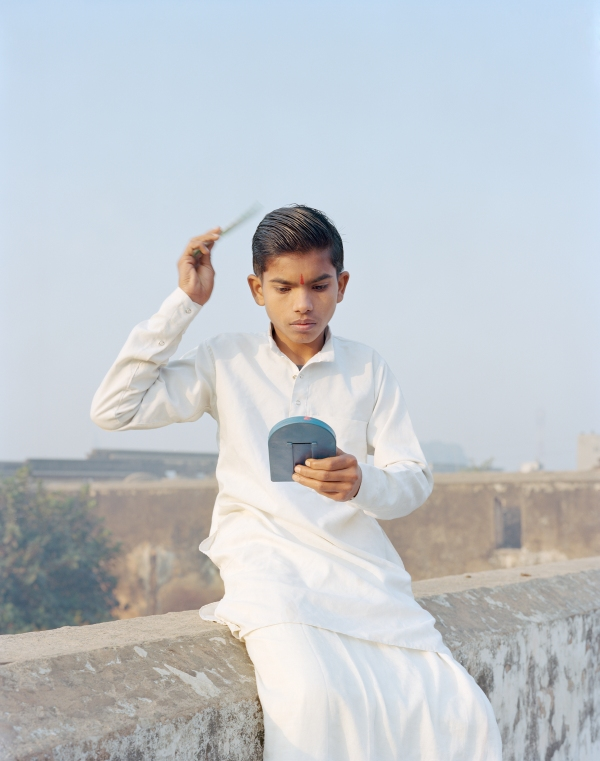 Rama Combing His Hair, Ayodhya, Uttar Pradesh, India, 2015, from the series A Myth of Two Souls by Vasantha Yogananthan