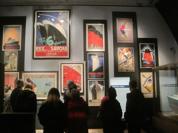 The wall of stylish Art Deco posters at Ocean Liners: Speed and Style at the Victoria and Albert Museum exhibition
