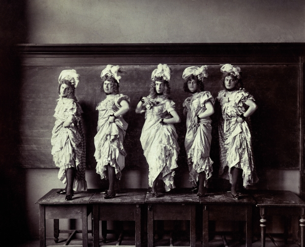Five performers on a platform. Albumen print, Hungary, circa 1900 © Sébastien Lifshitz Collection. Courtesy of Sébastien Lifshitz Collection and The Photographers' Gallery