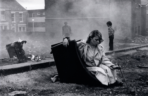 Karen on overturned chair (1980) Tish Murtha © Ella Murtha. Courtesy of Ella Murtha & The Photographers' Gallery