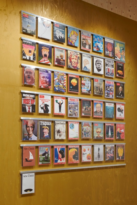 Wall of magazine covers lampooning the Donald. Photo by Benjamin Westoby