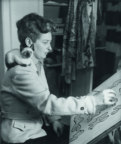 Enid Marx working on a textile design post-1945
