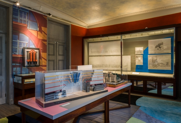 Installation view showing the large case of drawings for 1 Poultry, on the wall, and models of the TVam frontage and the SIS building by Terry Farrell on the table