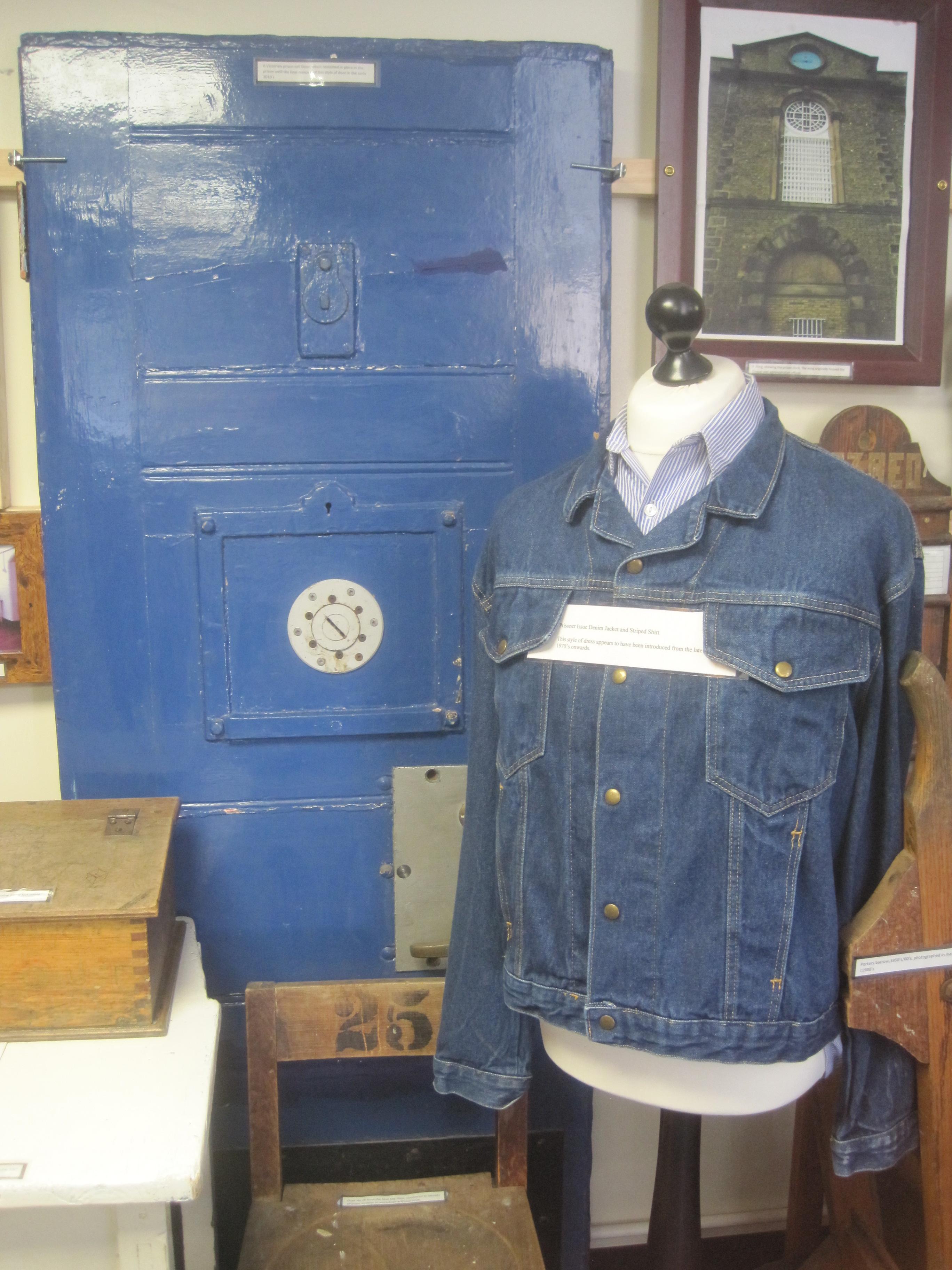be47f5c9ff Prison door and prison uniform
