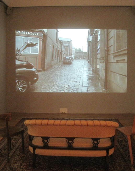 Comfy sofa in front of Civil Rites by Andrea Luka Zimmerman (2017)