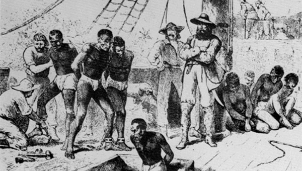 Africans being shackled and packed into a slave ship