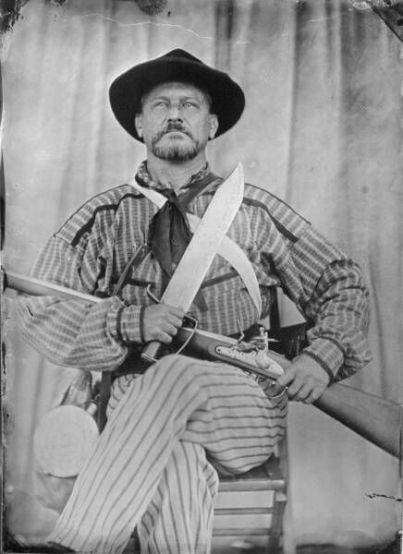 One of Quantrill's Raiders, the best-known of the pro-Confederate partisan guerrillas (or bushwhackers) who fought in the American Civil War. Their leader was William Quantrill and they included Jesse and Frank James.