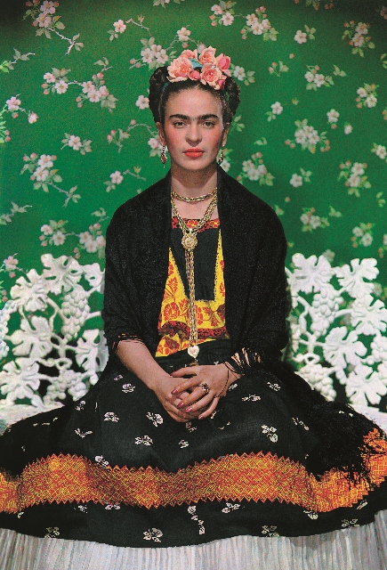 Frida Kahlo on a bench, carbon print (1938) Photo by Nickolas Muray © The Jacques and Natasha Gelman Collection of 20th Century Mexican Art and The Verge, Nickolas Muray Photo Archives