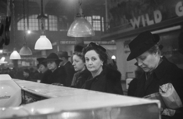 Customers waiting in line at a butcher's counter during wartime rationing, Washington Market, New York, 1941-44 by Roman Vishniac © Mara Vishniac Kohn