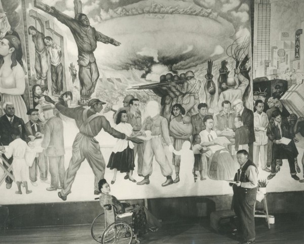 Diego Rivera and Frida Kahlo in front of the unfinished mural, The Nightmare of War and the Dream of Peace (1952) Photo by Juan Guzmán