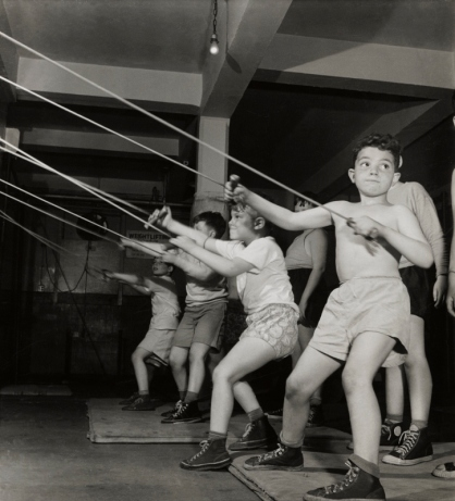 Boys exercising in the gymnasium of the Jewish Community House of Bensonhurst, Brooklyn (1949) by Roman Vishniac © Mara Vishniac Kohn