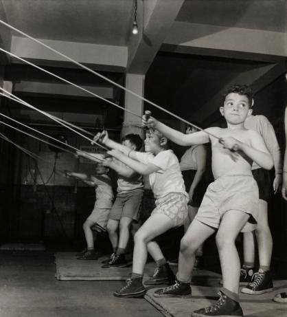 Boys exercising in the gymnasium of the Jewish Community House of Bensonhurst, Brooklyn (1949) by Roman Vishniac © Mara Vishniac Kohn