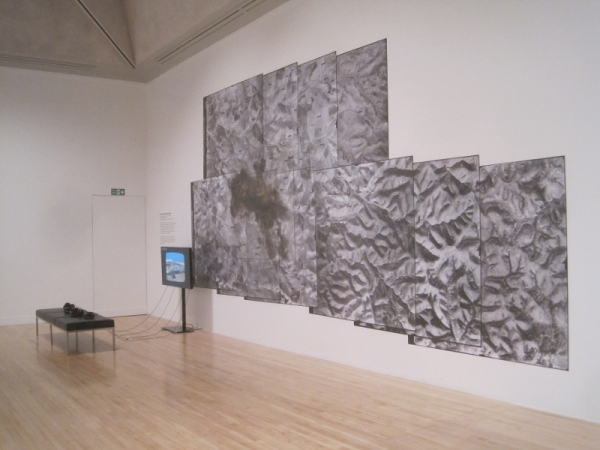 Installation view of Traces of Bedouin habitation 1945-present showing headphones which give commentary and explanation