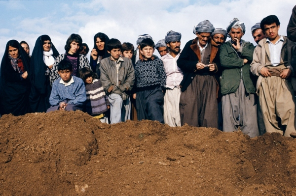 Villagers watch exhumation at a former Iraqi military headquarters outside Sulaymaniyah, Northern Iraq, 1991 by Susan Meiselas © Susan Meiselas