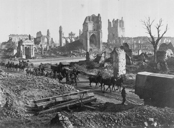 Horses and men of 1st Anzac Corps on their way past the ruins of the Cathedral and Cloth Hall in Ypres © IWM E(AUS) 1122
