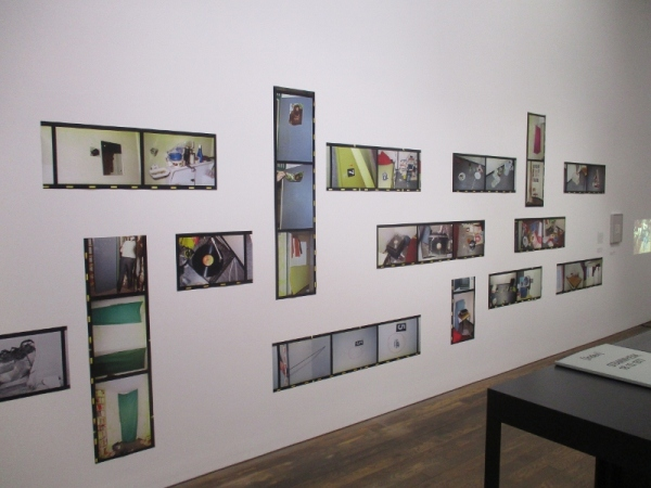 RAF – No Evidence/Kein Beweisby Arwed Messmer showing the wall of photos depicting the inside of the Baader - Meinhof cells at Stammheim Prison